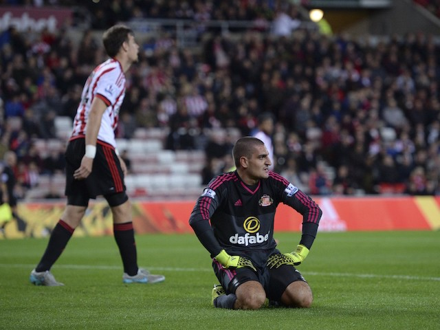 Sunderland's Italian goalkeeper Vito Mannone (R) reacts after Manchester City's third goal which was an own goal credited to Mannone after the ball ricocheted off the post to go in off the goalkeeper during the English League Cup third round football matc