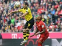 Dortmund's Armenian midfielder Henrikh Mkhitaryan (L) and Bayern Munich's defender Jerome Boateng (R) vie for the ball during the German first division Bundesliga football match FC Bayern Munich vs Borussia Dortmund in Munich, southern Germany, on October