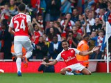 Alexis Sanchez of Arsenal celebrates scoring their third goal during the Barclays Premier League match between Arsenal and Manchester United at Emirates Stadium on October 4, 2015 in London, England.