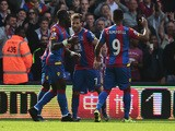 Yohan Cabaye (2nd R) of Crystal Palace celebrates scoring his team's second goal with his team mates during the Barclays Premier League match between Crystal Palace and West Bromwich Albion at Selhurst Park on October 3, 2015
