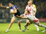 Adam Quinlan of St. Helens R.F.C pulls on Joel Moon of Leeds Rhinos during the First Utility Super League Semi Final between