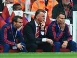 Louis van Gaal manager of Manchester United and Ryan Giggs assistant manager of Manchester United look on during the Barclays Premier League match between Arsenal and Manchester United at Emirates Stadium on October 4, 2015 in London, England.
