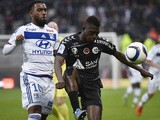 Lyon's French forward Alexandre Lacazette (L) vies with Reims' Malian defender Hamari Traore (R) during the French L1 football match between Olympique Lyonnais (OL) and Reims on October 3, 2015