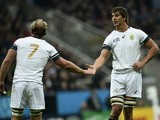 South Africa's flanker Schalk Burger (L) celebrates after scoring a try with South Africa's lock Eben Etzebeth during a Pool B match of the 2015 Rugby World Cup between South Africa and Scotland at St James' Park in Newcastle-upon-Tyne, north east England
