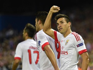 Benfica's Argentinian midfielder Nicolas Gaitan celebrates after scoring a goal during the UEFA Champions League football match Club Atletico de Madrid vs SL Benfica at the Vicente Calderon stadium in Madrid on September 30, 2015