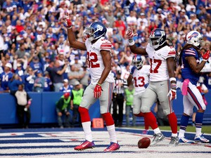 Rueben Randle #82 of the New York Giants celebrates a touchdown against the Buffalo Bills during the first half at Ralph Wilson Stadium on October 4, 2015