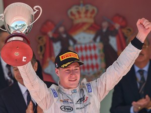 Belgian driver Stoffel Vandoorne holds his trophy as he celebrates after winning the GP2 series race at the Monaco street circuit in Monte-Carlo on May 22, 2015