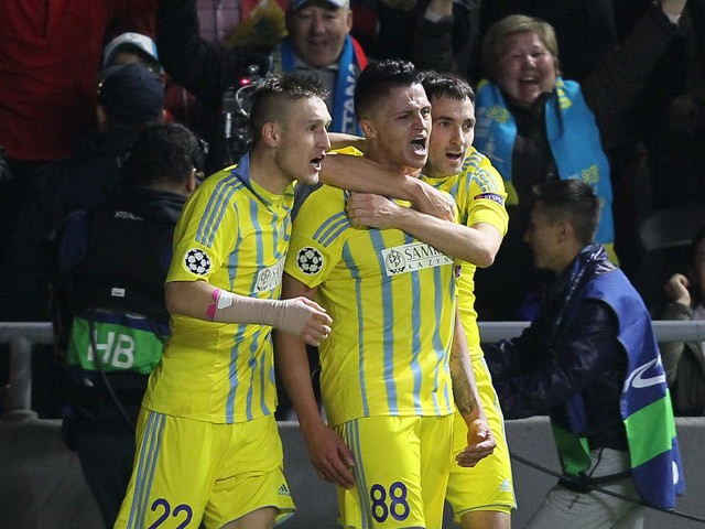 Astana's players celebrate a goal during the UEFA Champions League group C football match between FC Astana and Galatasaray AS at the Astana Arena stadium in Astana on September 30, 2015