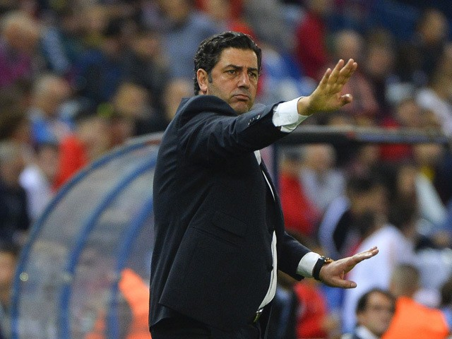 Benfica's coach Rui Vitoria gestures during the UEFA Champions League football match Club Atletico de Madrid vs SL Benfica at the Vicente Calderon stadium in Madrid on September 30, 2015