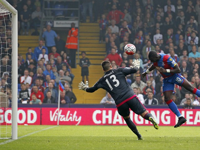Crystal Palace's French-born Congolese midfielder Yannick Bolasie (2nd L) scores past West Bromwich Albion's US-born Welsh goalkeeper Boaz Myhill (L) for the opening goal of the English Premier League football match between Crystal Palace and West Bromwic