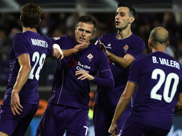 Fiorentina's Slovenian midfielder Josip Ilicic celebrates with teammates after scoring a penalty during the Italian Serie A football match Fiorentina vs Atalanta at the Artemio Franchi Stadium in Florence on October 4, 2015