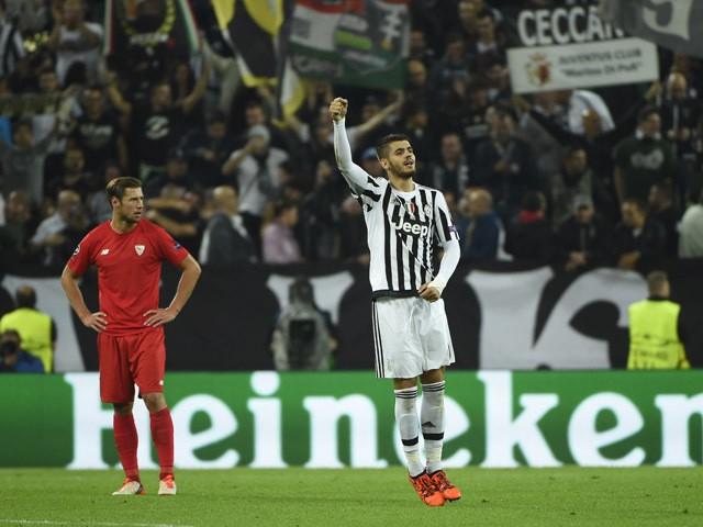 Juventus' forward from Spain Alvaro Morata celebrates after scoring during the UEFA Champions League football match Juventus vs FC Sevilla on September 30, 2015