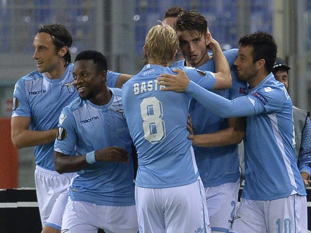 Lazio's defender from Netherlands Wesley Hoedt (C) celebrates with teammates after scoring during UEFA Europa League football match Lazio versus Saint Etienne at Rome's Olympic stadium, on October 1, 2015
