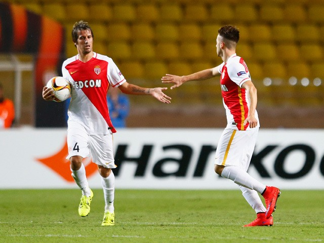 Fabio Coentrao of Monaco congratulates Stephan El Shaarawy of Monaco on scoring their first goal during the UEFA Europa League group J match between AS Monaco FC and Tottenham Hotspur FC at Stade Louis II on October 1, 2015