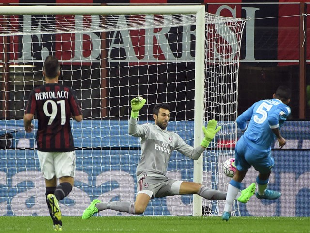 Napoli's Brazilian midfielder Allan (R) shoots to score past AC Milan's Spanish goalkeeper Diego Lopez during the Italian Serie A football match between AC Milan and Napoli at San Siro Stadium in Milan on October 4, 2015