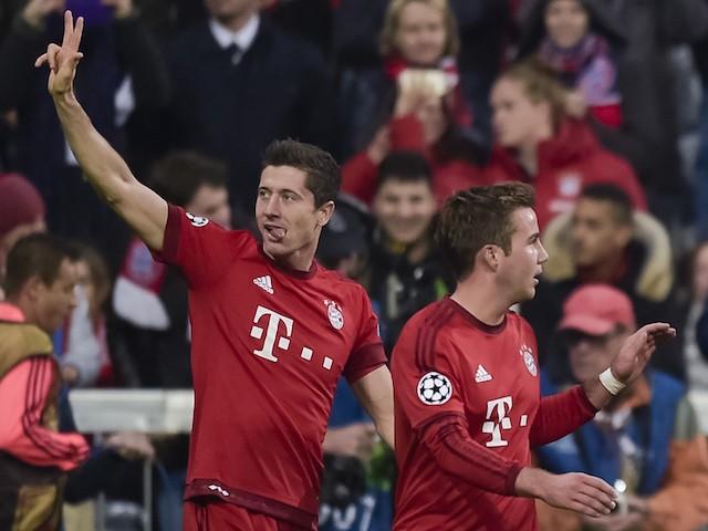 Bayern Munich's Polish striker Robert Lewandowski (L) celebrates after scoring the fifth goal during the Group F, first-leg UEFA Champions League football match FC Bayern Munich vs GNK Dinamo Zagreb in Munich, on September 29, 2015.