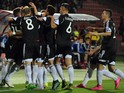 Albania's players celebrate after scoring a goal during the Euro 2016 group I qualifying football match between Armenia and Albania on October 11, 2015 at the Replubican stadium in Yerevan.