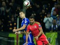 Hal Robson-Kanu (R) of Wales jumps for the ball against Toni Sunjic (L) of Bosnia of the Euro 2016 qualifying football match between Bosnia and Herzegovina and Wales at the Stadium Bilino Polje in Elbasan on October 10, 2015.