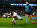Anthony Watson of England scores the first try during the 2015 Rugby World Cup Pool A match between England and Uruguay at Manchester City Stadium on October 10, 2015 in Manchester, United Kingdom.
