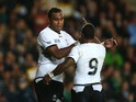 Leone Nakarawa of Fiji (L) celebrates with Nemia Kenatale as he scores their fourth try during the 2015 Rugby World Cup Pool A match between Fiji and Uruguay at Stadium mk on October 6, 2015 in Milton Keynes, United Kingdom.