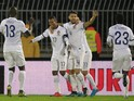Nani (C) of Portugal celebrates scoring a goal with team mates Miguel Veloso (R) and Danilo (L) during the Euro 2016 qualifying football match between Serbia and Portugal at the Stadium FC Partizan in Belgrade on October 11, 2015.