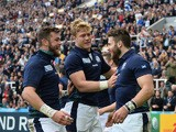 Scotland's wing Tommy Seymour (R) celebrates with teammates after scoring his team's first try during a Pool B match of the 2015 Rugby World Cup between Scotland and Samoa at St James' Park in Newcastle-upon-Tyne, northeast England, on October 10, 2015