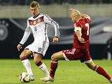 Georgia's midfielder Jaba Kankava (R) and Germany's midfielder Toni Kroos vie for the ball during the Euro 2016 Group D qualifying football match between Germany and Georgia in Leipzig, eastern Germany, on October 11, 2015.