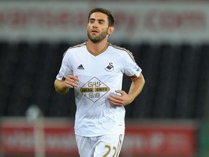 Swansea player Angel Rangel in action during the Capital One Cup Second Round match between Swansea City and York City at Liberty Stadium on August 25, 2015