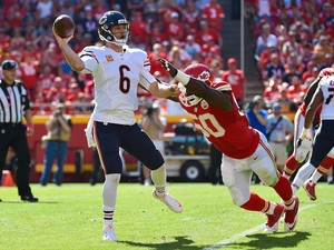 Jay Cutler (6) of the Chicago Bears throws the ball avoiding the attempted sack of Justin Houston (50) of the Kansas City Chiefs at Arrowhead Stadium during the game on October 11, 2015 in Kansas City, Missouri.