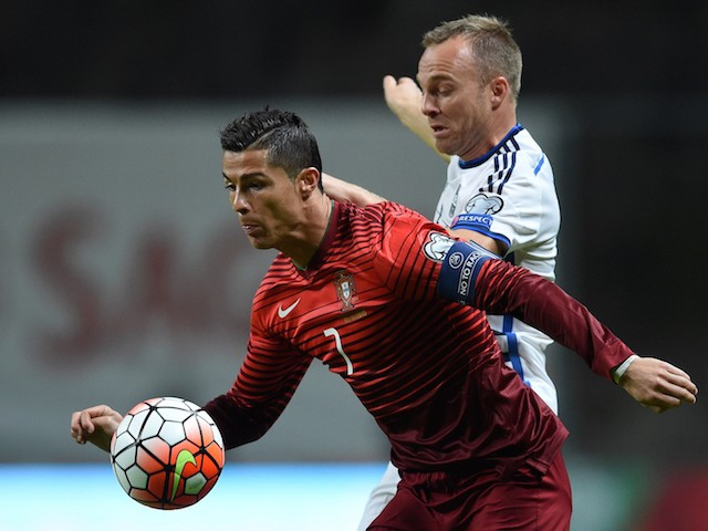 Portugal's forward Cristiano Ronaldo (L) vies with Denmark's defender Lars Jacobsen during the Euro 2016 qualifying football match Portugal vs Denmark at the Municipal stadium in Braga on October 8, 2015.