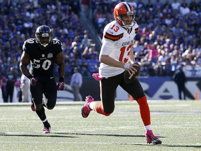 Quarterback Josh McCown #13 of the Cleveland Browns scores a third quarter touchdown past outside linebacker Albert McClellan #50 of the Baltimore Ravens during a game at M&T Bank Stadium on October 11, 2015 in Baltimore, Maryland.