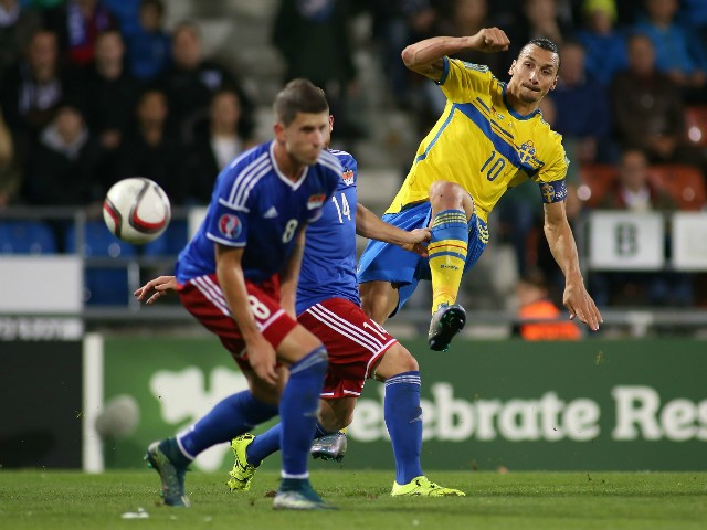 Swedens forward Zlatan Ibrahimovic (R) vies with Liechtensteins defenders Sandro Wieser and Yves Oehri during the Euro 2016 Group G qualifying football match between Liechtenstein and Sweden at the Rheinpark stadium in Vaduz on October 9, 2015.