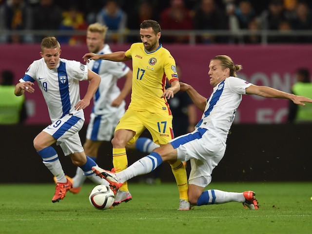 Lucian Sanmartean (L) of Romania is tackled by Markus Halsti of Finland during the UEFA EURO 2016 Qualifier between Romania and Finland on October 8, 2015 in Bucharest, Romania.