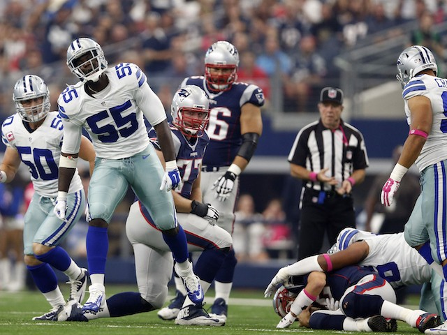 Middle linebacker Rolando McClain #55 of the Dallas Cowboys celebrates a sack against quarterback Tom Brady #12 of the New England Patriots in the first quarter at AT&T Stadium on October 11, 2015 in Arlington, Texas.