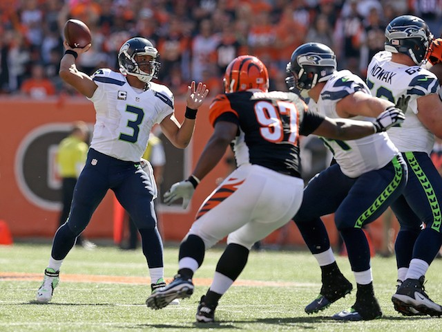 Russell Wilson #3 of the Seattle Seahawks drops back and throws a pass during the second quarter of the game against the Cincinnati Bengals at Paul Brown Stadium on October 11, 2015 in Cincinnati, Ohio.