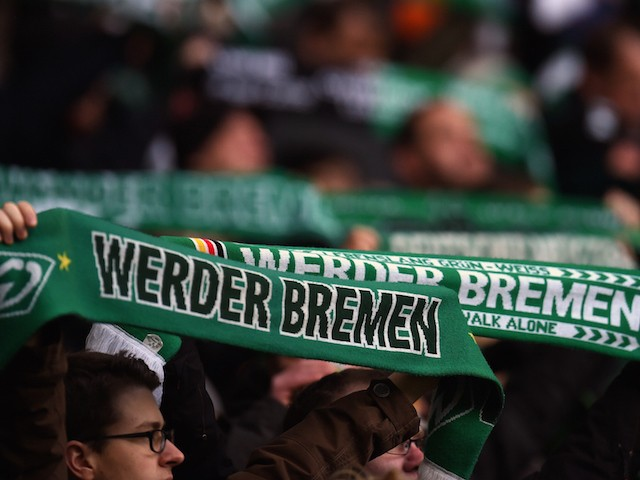 Bremen's fans wave with scarves prior to the German first division Bundesliga football match SV Werder Bremen vs VfL Wolfsburg in Bremen, western Germany, on March 1, 2015.