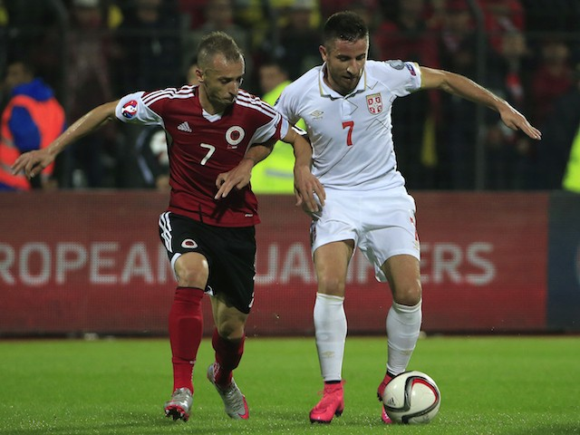 Zoran Tosic (R) of Serbia in action against Ansi Agolli (L) of Albania during the UEFA EURO 2016 qualifier between Albania and Serbia at the Elbasan Arena on October 08, 2015 in Elbasan, Albania .