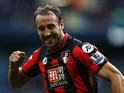 Glenn Murray of Bournemouth celebrates scoring his team's first goal during the Barclays Premier League match between Manchester City and A.F.C. Bournemouth at Etihad Stadium on October 17, 2015