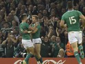 Ireland's wing Luke Fitzgerald (2nd L) celebrates with Ireland's scrum half Conor Murray (L) after scoring his team's first try during a quarter final match of the 2015 Rugby World Cup between Ireland and Argentina at the Millennium Stadium in Cardiff, so