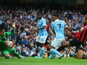Raheem Sterling of Manchester City scores his team's first goal during the Barclays Premier League match between Manchester City and A.F.C. Bournemouth at Etihad Stadium on October 17, 2015