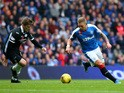 Martyn Waghorn of Rangers takes on Jake Pickard of Queen of the South during the Scottish Championship match between Glasgow Rangers FC and Queen of the South FC at Ibrox Stadium on October 17, 2015