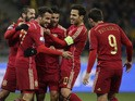 Spain's players celebrate after scoring during the Euro 2016 qualifying football match between Ukraine and Spain at Olympiysky stadium in Kiev on October 12, 2015