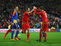 Gareth Bale of Wales celebrates with Aaron Ramsey (R) as he scores their second goal during the UEFA EURO 2016 qualifying Group B match between Wales and Andorra at Cardiff City Stadium on October 13, 2015