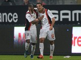 Nice's French forward Hatem Ben Arfa (R) celebrates with his teammate Nice's Portuguese defender Ricardo Pereira after scoring a goal during the French L1 football match between Rennes and Nice on October 18, 2015