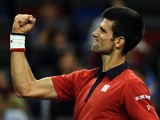 Novak Djokovic of Serbia celebrates after winning his men's singles semi-final match against Andy Murray of Britain at the Shanghai Masters tennis tournament in Shanghai on October 17, 2015