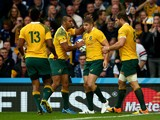 Kurtley Beale of Australia congratulates Drew Mitchell after he scored his teams second try during the 2015 Rugby World Cup Quarter Final match between Australia and Scotland at Twickenham Stadium on October 18, 2015 in London, United Kingdom.