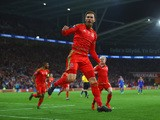 Wales player Aaron Ramsey celebrates after scoring the first goal during the UEFA EURO 2016 Group B Qualifier between Wales and Andorra at Cardiff City stadium on October 13, 2015