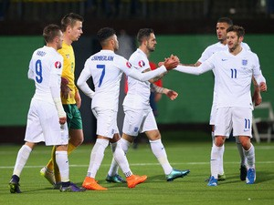 Alex Oxlade-Chamberlain of England (7) celebrates with Adam Lallana (11) as he scores their third goal during the UEFA EURO 2016 qualifying Group E match between Lithuania and England at LFF Stadionas on October 12, 2015