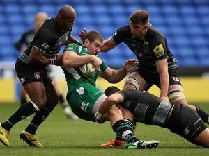 Jebb Sinclair of London Irish is tackled by Seremaia Bai (L), Mike Williams (R) and Mike Fitzgerald of Leicester during the Aviva Premiership match between London Irish and Leicester Tigers at Madejski Stadium on October 18, 2015