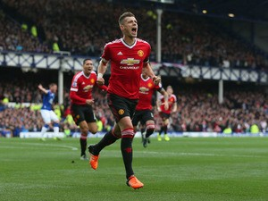Morgan Schneiderlin of Manchester United celebrates scoring his team's first goal during the Barclays Premier League match between Everton and Manchester United at Goodison Park on October 17, 2015